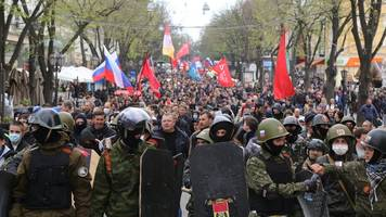 Ukraine quashes separatists; Putin warns of civil war